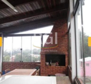 Ampla casa  de 4 dormitórios, no bairro Nonoai, em Porto Alegre, living para 3 ambientes com sacada, lavabo, cozinha, garagem coberta para 2 carros, pátio com churrasqueira, jardim, banheiro social, banheiro auxiliar, 1 andar quartos com sacada, com linda vista para Guaiba, escritório com lareira, possui área de lazer com churrasqueira e terraço com vista perene. Aceita imóvel como parte de pagamento. Vale a pena conferir!!Terreno com 15m de frente e 23m de fundos, com 44m de frente a fundos.